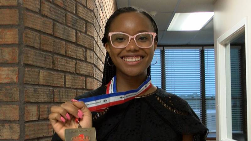 Micah Hill poses with her state championship medal.