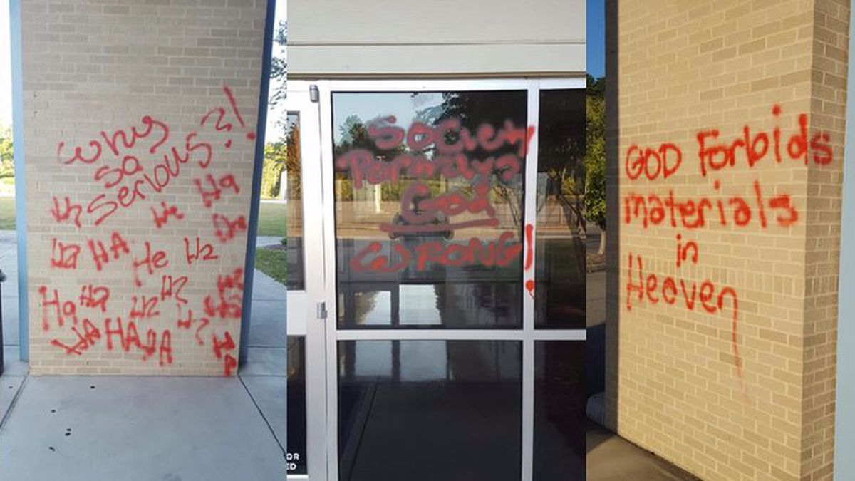 Red spray paint covers multiple windows, walls and doors at Venture Church.