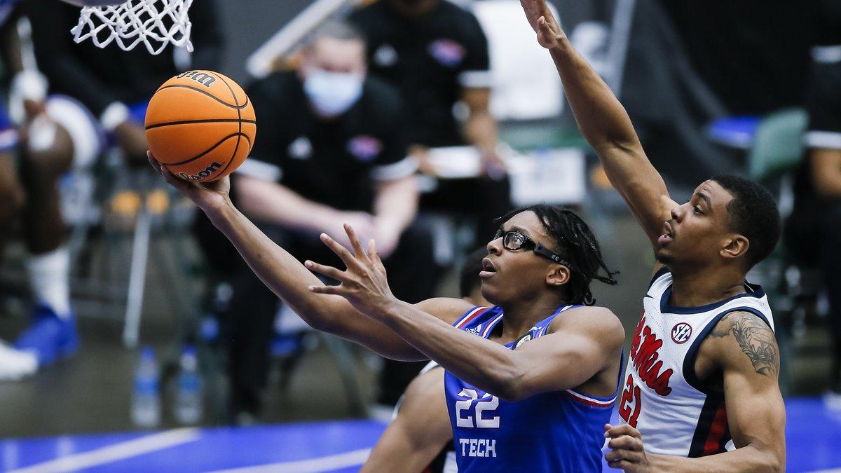 Louisiana Tech forward Isaiah Crawford (22) attempts a layup as Mississippi forward Robert...