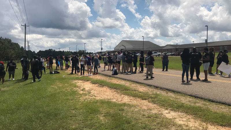 Oak Grove High School students protest outside the school.