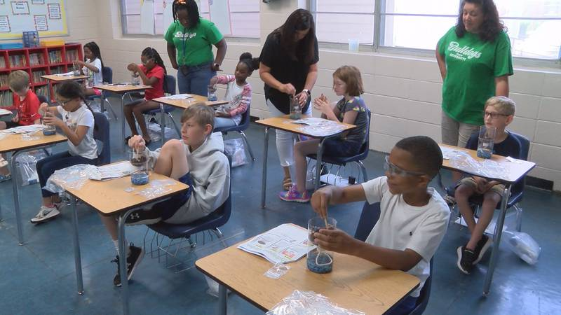 Students work on a science project during summer school at Seminary Elementary School Wednesday.