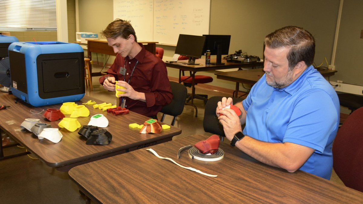 Jones College's Electro-Mechanical Technology instructor, Cody Robertson (left) puts the...