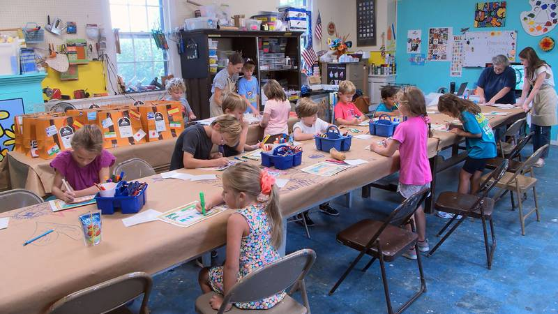 Over 40 kids learn about art styles from around the world.
