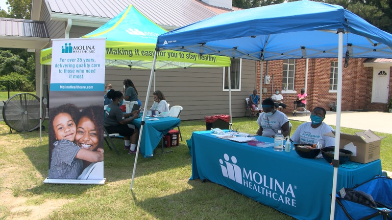 Backpacks and COVID vaccines given away by Molina Healthcare
