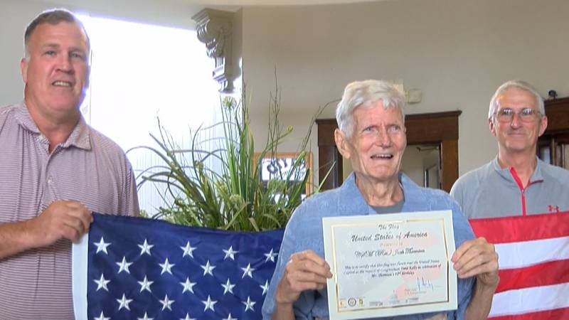 Mr. Jack Thornton, a retired U.S. Army Veteran, receives a flag flown over the U.S. Capitol in...