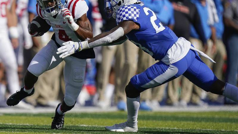 Kentucky defensive back Tyrell Ajian (23) tackles Mississippi running back Tylan Knight (4)...