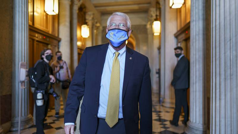 Sen. Roger Wicker, R-Miss., leaves the Senate chamber following a procedural vote on the...