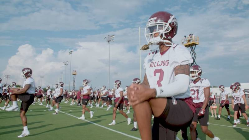 Mississippi State Bulldogs stretch during fall camp.