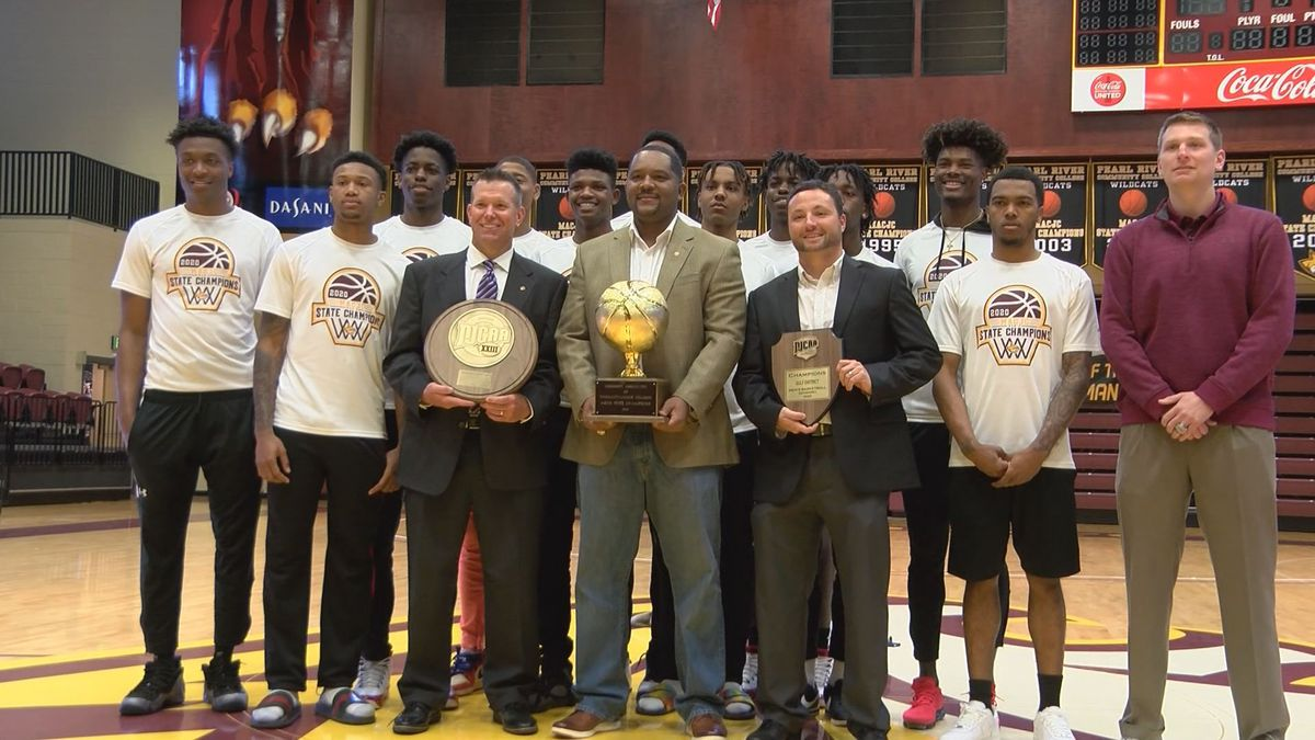 The Pearl River men's basketball team poses with their state and region championships