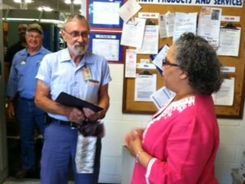 Mail carrier Paul McNeil was the guest of honor at a party Friday morning recognizing his 55...