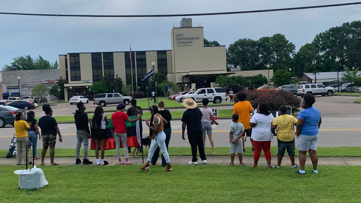 The group gathered outside of the city's law enforcement complex on Tuesday.