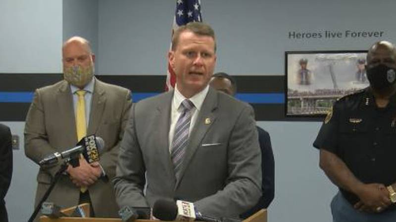 U.S. Attorney Mike Hurst, flanked by leaders from several law enforcement agencies, held a news...