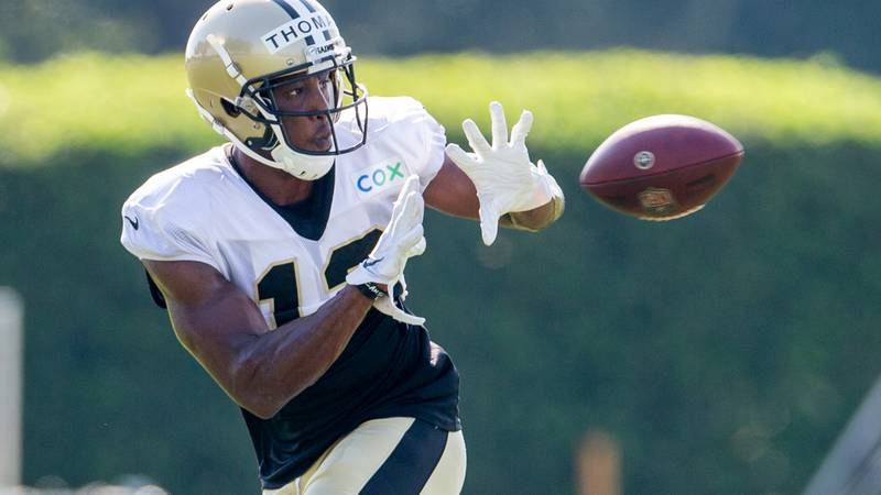 New Orleans Saints wide receiver Michael Thomas (13) catches the ball during an NFL football...