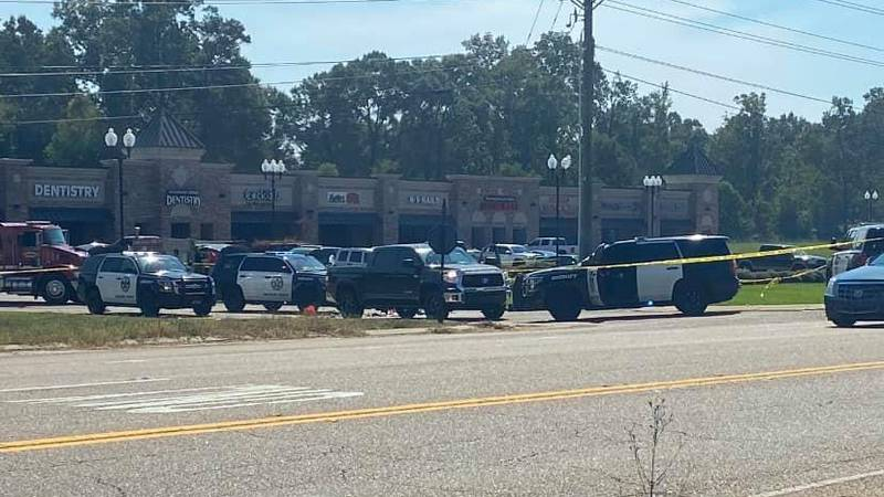 Dozens of Madison County sheriff deputies are  on the scene with crime scene tape around the...