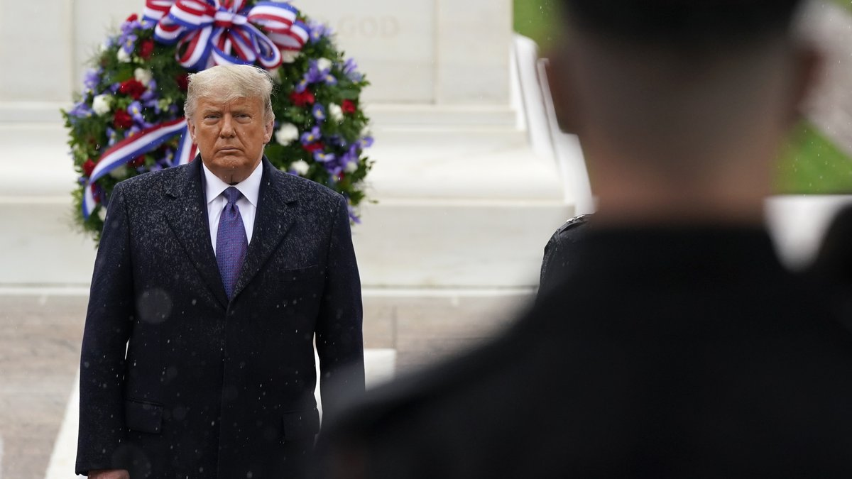 President Donald Trump participates in a Veterans Day wreath laying ceremony at the Tomb of the...