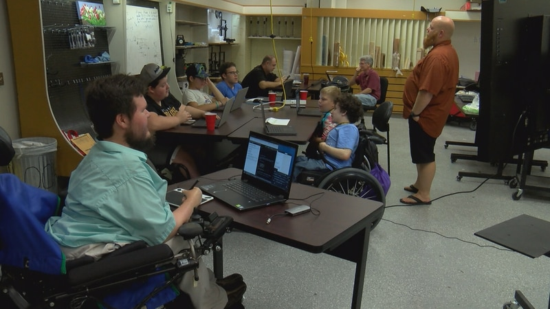 Students at USM's Eagle Maker Hub take part in a Hackability Camp Saturday.
