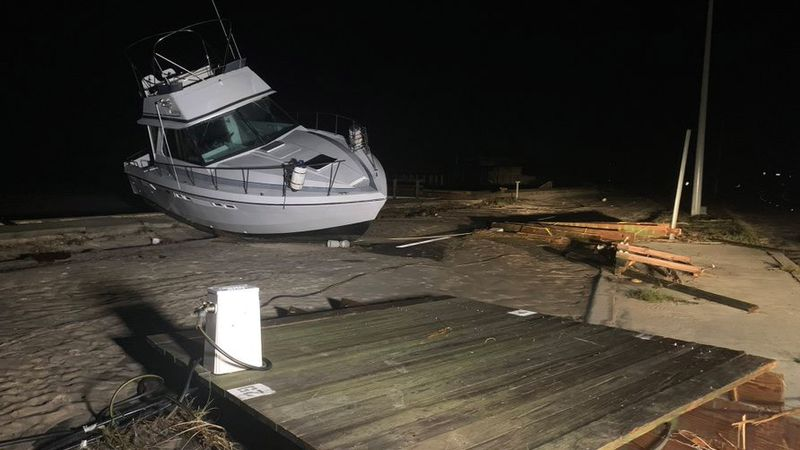 A boat is now blocking the eastbound lanes of Highway 90 in Long Beach, Miss., along with other...
