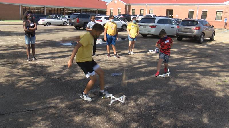 """Students at a STEM camp at William Carey University launch home-made """"stomp rockets"""" Tuesday."""