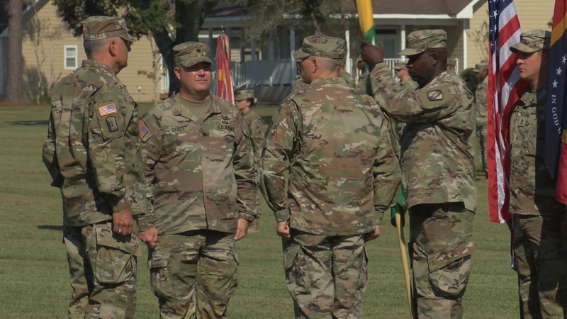 Lt. Col. (P) Michael Dykes (2nd from left) takes command of the 155th ABCT at Camp Shelby...