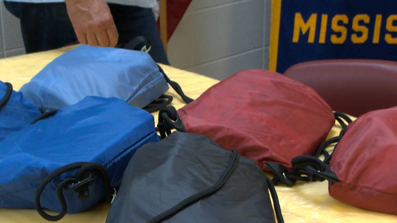 The bags contain items like snacks, water and stuffed animals.