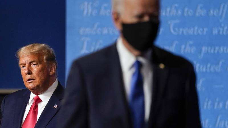 FILE - President Donald Trump, left, remains on stage as then-Democratic presidential candidate...
